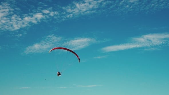 Thumbnail for Hang Glider Flying Over a Field