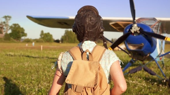 Cover Image for A Confident Young Female Pilot Walking To a Plane