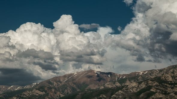 Cover Image for Of Clouds Moving Over Mountain