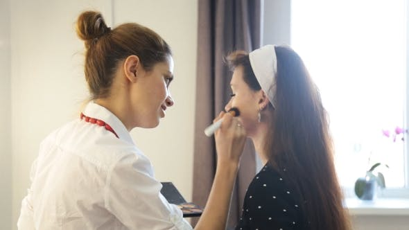 Thumbnail for Make-up Artist Doing Make Up For Young Girl