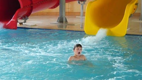 Happy Child Having Fun In Aquapark