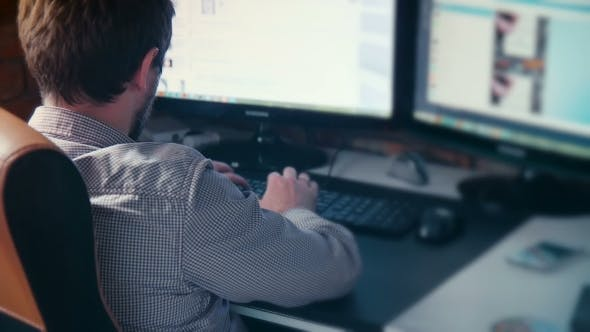 Thumbnail for Man Working At Computer In Contemporary Office