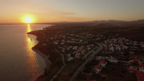 Thumbnail for Aerial View of Coastal Resort Town with Cottages on the Shoreline, Greece