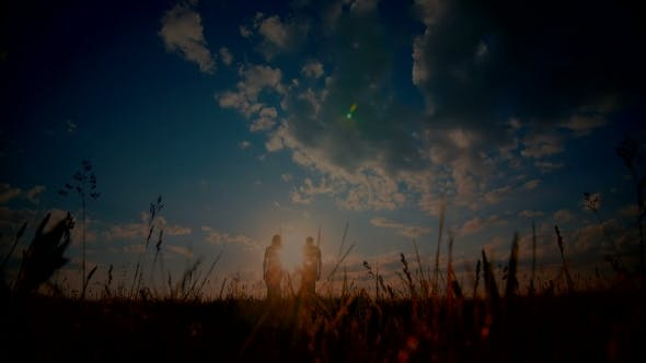 Thumbnail for Young Couple Enjoying The Sunset In The Meadow