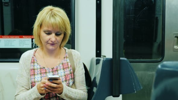 Thumbnail for A Woman Goes To The Subway Car, Typing On Mobile Phone