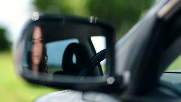 Thumbnail for Reflection Of Pretty Woman In Car Side-view Mirror