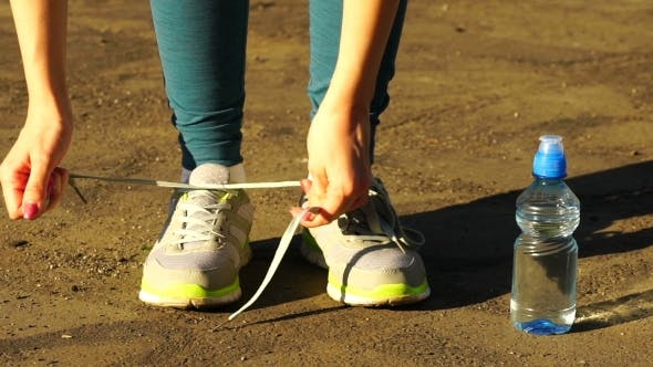 Thumbnail for Girl Stopped Running To Tie The Laces On Running Shoes. Fitness Girl Training Outdoors.  120Fps