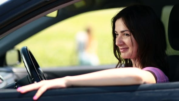 Thumbnail for Side View Of Attractive Woman Driver In Car Window