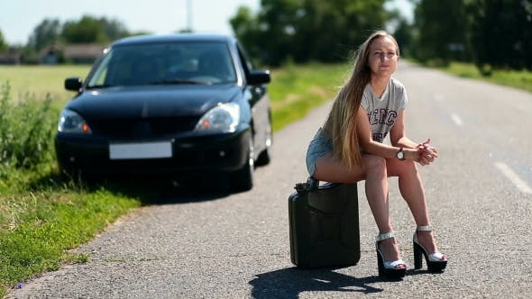 Thumbnail for Upset Sexy Girl Sitting On Rusty Canister On Road