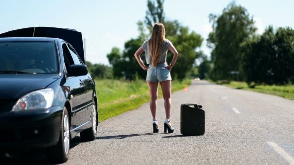 Thumbnail for Beautiful Girl Hitchhiking On Rural Road Back View