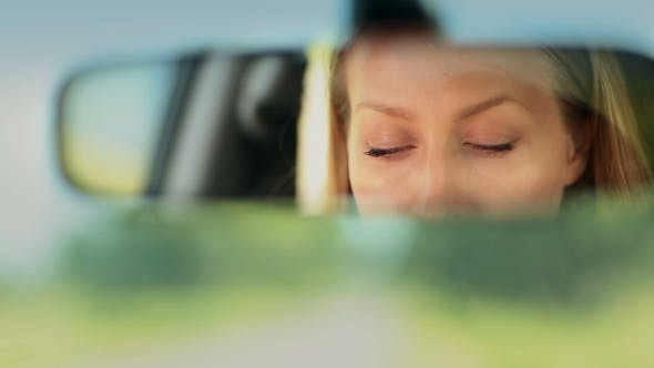 Thumbnail for Reflection Of Woman's Blue Eyes In Rearview Mirror