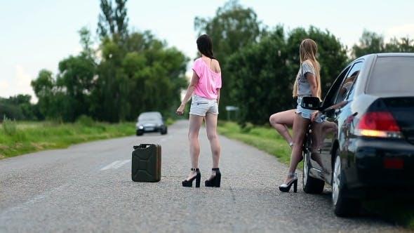 Thumbnail for Young Women Hitchhiking Near Broken Car