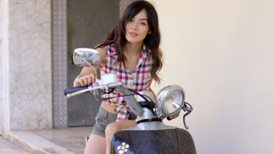Thumbnail for Attractive Young Woman On a Motorcycle
