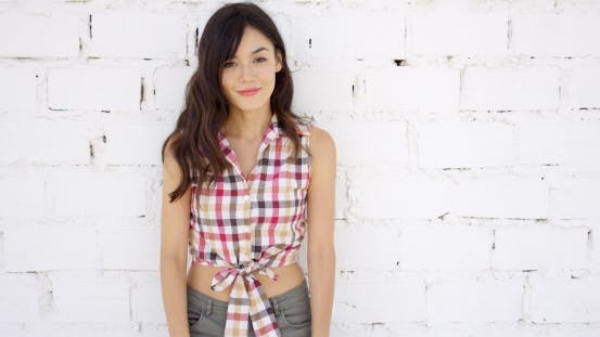 Thumbnail for Attractive Woman With Checkered Top And Shorts