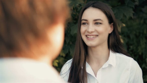 Thumbnail for Woman And Man Conversing. Young Attractive Female Chats And Flirts With Her Man, Outdoors