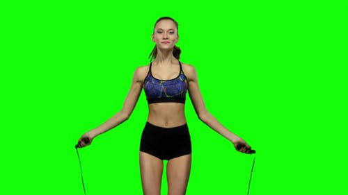 Woman Is Jumping With a Skipping Rope. Green Screen