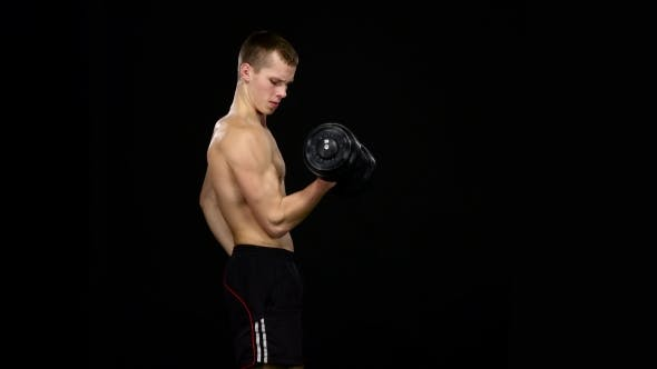Thumbnail for Man Does Bicep Exercise With Dumbbells In a Gym. Black
