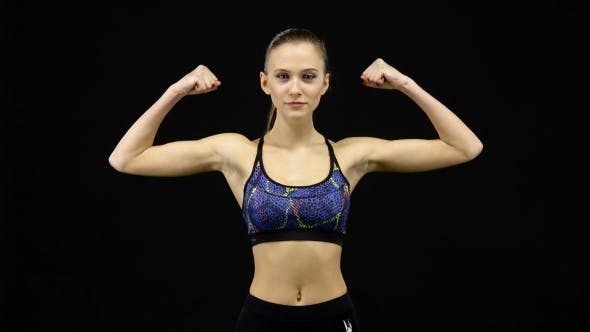Thumbnail for Woman Showing Off Muscles. Black
