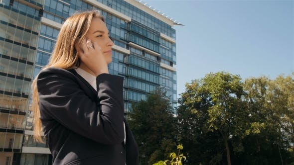 Thumbnail for Portrait Of Business Woman Making a Phone Call Outside Business Center