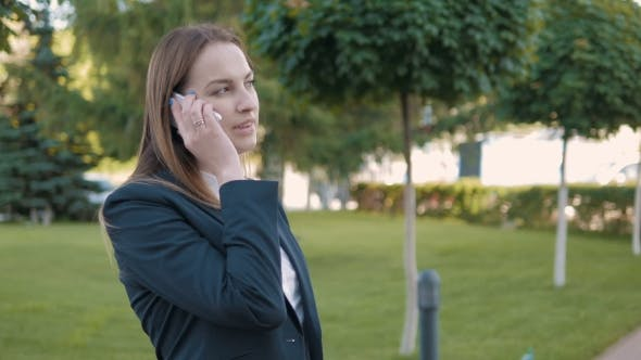 Thumbnail for Portrait Of Business Woman Making a Phone Call Outdoors