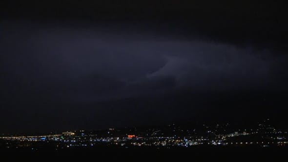 Cover Image for Thunderstorm In Night Illuminated City