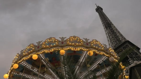 Thumbnail for Vintage Carousel And Eiffel Tower In The Evening