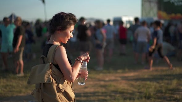 Thumbnail for Woman Drinking Water On Music Fest