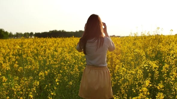 Thumbnail for Girl Walks Through Field, Straightens Hair