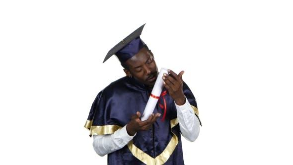 Thumbnail for Student Kissing Diploma. White