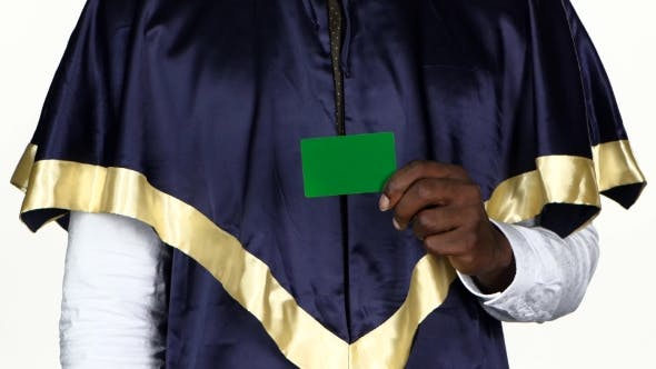 Thumbnail for Student Holding a Green Card And Shows The Thumb. White.