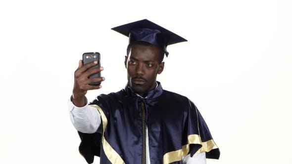 Graduate Makes Selfie Photo. White.