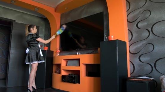 Thumbnail for Girl Cleans Dust On TV