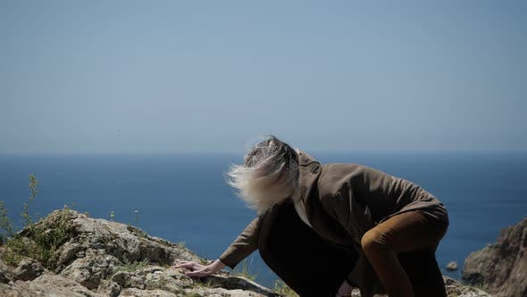 Thumbnail for Reaching the Top of a Mountain in Crimea Is a Young Man with Long Hair