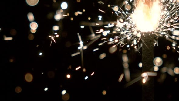Thumbnail for Burning Sparkler Against Black Background