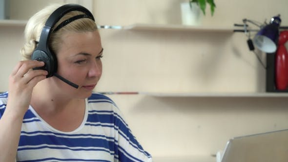 Thumbnail for Professional Woman Talking on the Headset With Friendly Smile