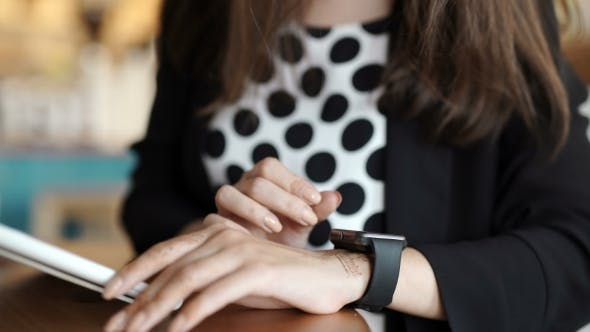 Cover Image for Woman With Smart Watch Working On Tablet