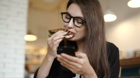 Thumbnail for Cafe City Lifestyle Woman On Phone Eating Sandwich
