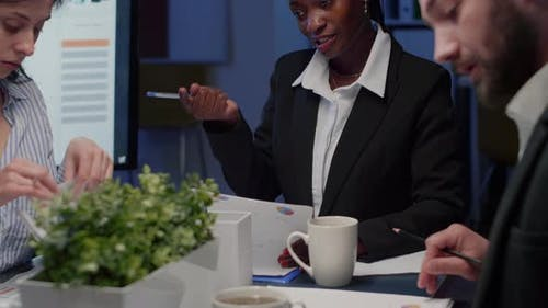 African American Businesswoman Brainstorming Business Strategy Working in Meeting Room