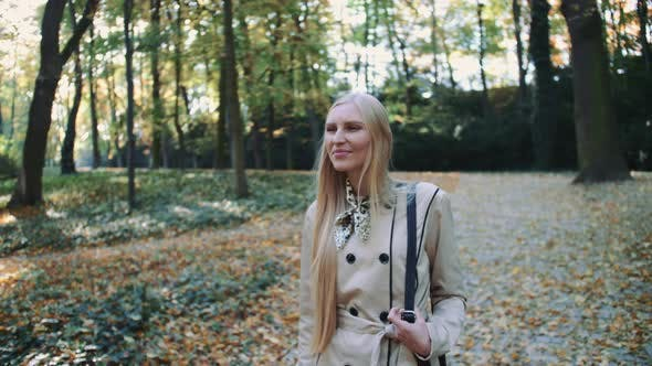 Thumbnail for Beautiful Young Blonde Girl Walking in the Park in Autumn