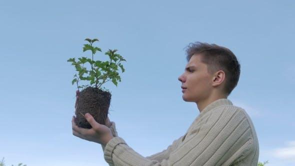 Thumbnail for Man Holding Plant