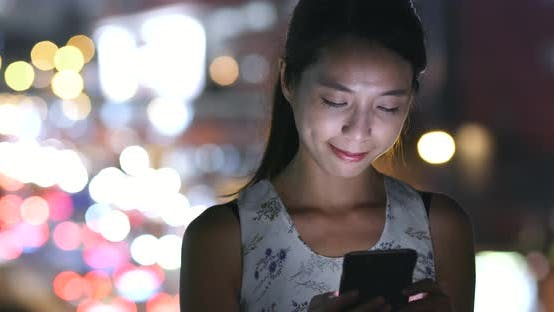 Cover Image for Woman use of mobile phone at night