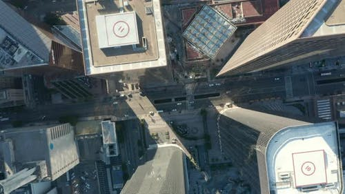 AERIAL: Slow Uplifting Birds Eye View Flight Over Downtown Los Angeles California Grand Avenue in