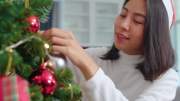Female teen happy smiling celebrate xmas winter holidays in living room.