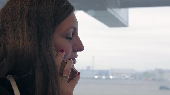 Thumbnail for Girl At Airport Talk On Phone