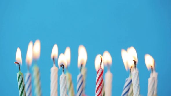 Thumbnail for Birthday Candles Burning Over Blue Background