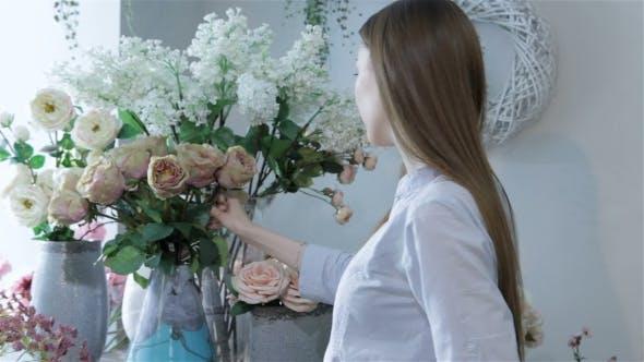 Thumbnail for Female Florist Arranges Flowers In Vases At Flower Shop