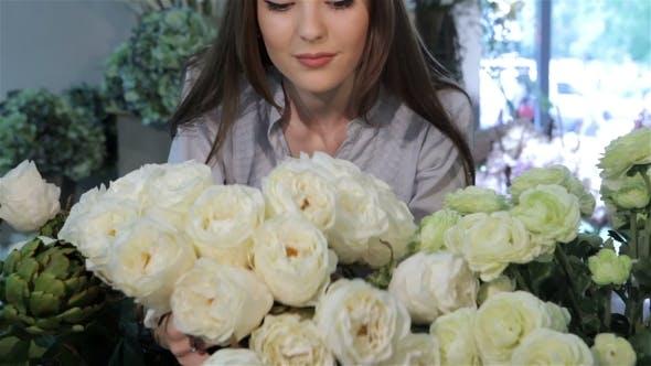 Thumbnail for Female Florist Looks At White Roses At Flower Shop