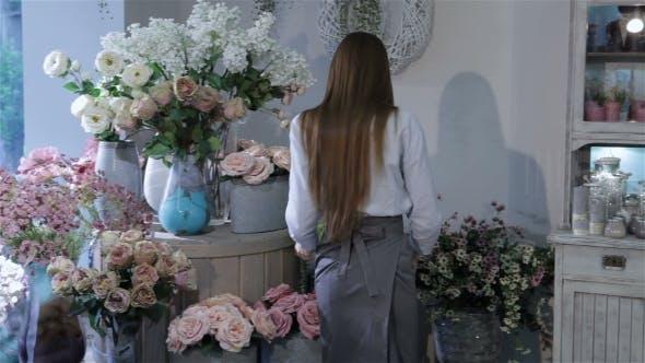 Thumbnail for Female Florist Rearranges Flowers At Flower Shop