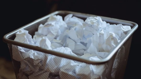 Recycle. Crumpled Paper Is Thrown In The Trash Can