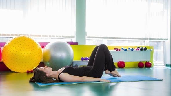 Thumbnail for Fitness Girl Doing Gluteal Bridge Pose On The Floor